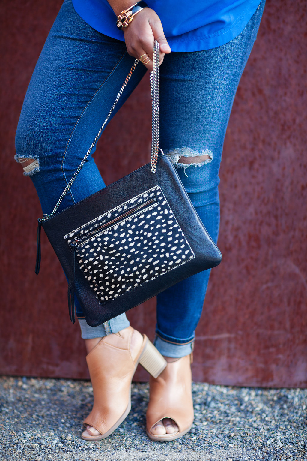 Now that Spring has officially arrived, it's time to move those winter clothes to the back of the closet. I picked up this calf hair purse (winter handbag), and want it to work for Spring.